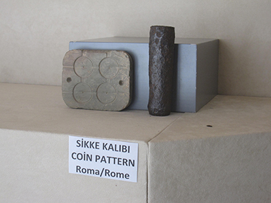 Coining stamp and coin blank mould. Photo: KW.