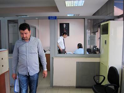 Mr. Özen battling Turkish bureaucracy. Photo: KW.