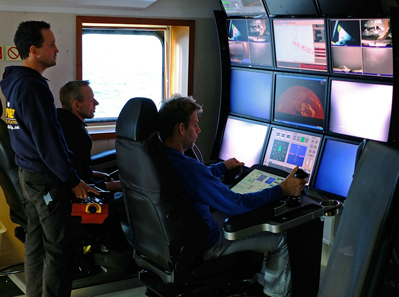 Odyssey Senior Project Manager Andrew Craig directs operations on the SS Gairsoppa shipwreck site from the ROV control room aboard the Seabed Worker. Photo: Odyssey Marine Exploration, Inc., www.odysseymarine.com