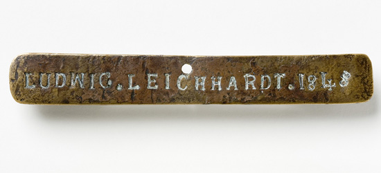 Brass nameplate of Ludwig Leichardt 1848, discovered attached to a partly burnt firearm in a bottle tree near Sturt Creek, Western Australia, by an Aboriginal stockman named Jackie. Photo: Dragi Markovic, National Museum of Australia.