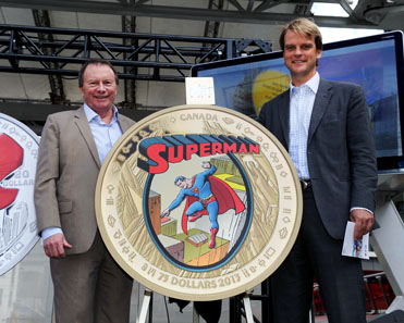 From left to right: Royal Canadian Mint President and CEO Ian E. Bennett and Canada's Minister of Citizenship and Immigration Chris Alexander unveiled a new series of collector coins on September 9, 2013, at Toronto's Yonge-Dundas Square, to commemorate the 75th anniversary of the co-creation of Superman by Canadian Joe Shuster and his American collaborator Jerry Siegel.