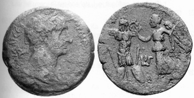 Trajan, 98-117. AE, 109/110. Rev. Nike with palm branch, crowning a trophy. MMDe 14 (2004), 766.