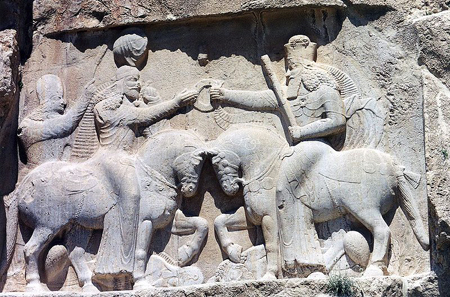 Ardashir I is given the ring of power by Ahura Mazda. Rock relief of Naqsh-e-Rostam. Photograph: Ginolerhino / http://creativecommons.org/licenses/by-sa/3.0/deed.en