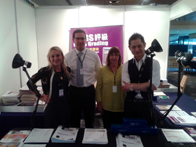 Muriel Eymery, PCGS Vice President of International Business Development, with ANDA President Andrew Crellin, ANDA Executive Director Annette Power and PCGS Asia Senior Business Director Collins Chu at the October 2013 ANDA International Coin and Banknote Show in Melbourne, Australia.