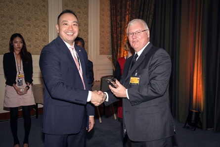 Winner of the Best New Circulating Coin Innovation, Process or Product accepted by Lenard Cheung, Royal Canadian Mint (left). Presentation made by Rick Haycock, IACA.