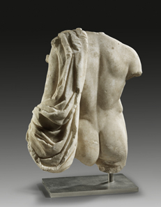 1: Torso of Hermes. White, finely crystalline marble. H 45 cm. Roman Imperial Period, 1st-2nd cent. AD. Estimate: 40,000 euros.