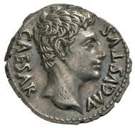 Roman Imperial Era. Augustus (27 BC-14 AD). Denarius, Cologne, 19 BC. Head of Augustus in idealized form facing right. Rev. Clupeus Virtutis (see text), to the left, eagle, and to the right, battle standards. © MoneyMuseum, Zurich.