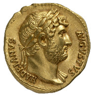 Roman Imperial Era. Hadrian (117-138). Aureus, 128. Head of Hadrian with laurel wreath facing right, delicate draping on his left shoulder. Rev. the Emperor as commander atop his rearing horse, riding to the right. © MoneyMuseum, Zurich.