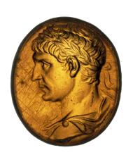 Traianus, bust with laurel, after Traianus' death, c.115-117 CE. Glass paste, 16 x 14mm. © Musée d'art et d'histoire, Geneva. Inv. CdN, MF 2967.