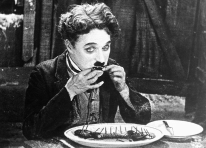 The Tramp resorts to eating his boot in a famous scene from 'The Gold Rush' (1925)/ Wikipedia.