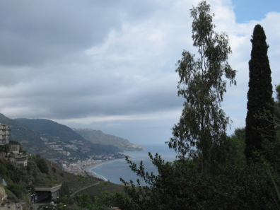 The picturesque bay of Taormina in a slightly less picturesque rain shower. Photo: KW.