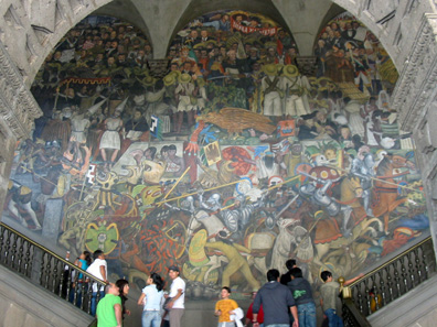 One of the monumental socio-critical wall paintings at Palacio Nacional, painted by Diego Rivera. When we visited the site it had already become much too dark to take a picture of it. Photograph: Wikipedia / Thelmadatter.