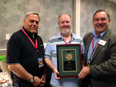 Club member, Donald Cleland receiving the President's Award at the show by Walter Ostromecki, American Numismatic Association president with Joe Cavallero, LVNS president. Photo: CKShows.com