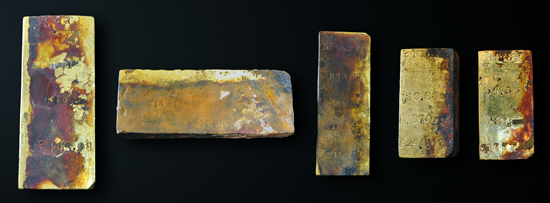 Five gold bars, totaling approximately 1,000 ounces, were recovered by Odyssey Marine Exploration during the first reconnaissance dive to the 2,200 meter deep SS Central America shipwreck site in April 2014. The bars were stamped with various assayer's marks and weights that range from 96.5 to 313.5 troy ounces. Copyright: Odyssey Marine Exploration, Inc., www.OdysseyMarine.com.