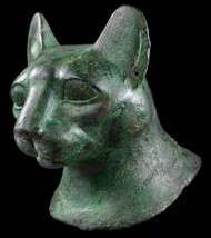 Egyptian bronze head of a cat. Late Dynastic Period. 25th-31st Dynasty, 715-332 BC Height: 10.1 cm. Provenance: Collection of Michael Inchbald, London acquired from Spink & Son, London in the early 1960s. Asking price: £75,000.