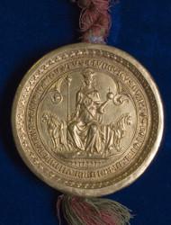 Goldbulle. Goldbulle Kaiser Ludwigs IV. des Bayern. Gold, an geflochtenen Seidenschnüren anhängend. Italien, 1327/28. Stadtarchiv Passau (Urk. I, 43). Foto: Stadtarchiv Passau.