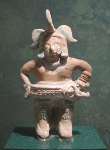 Figure of a ball player. 6th cent. A. D. National Museum of Culture / Mexico City. Photograph: UK.