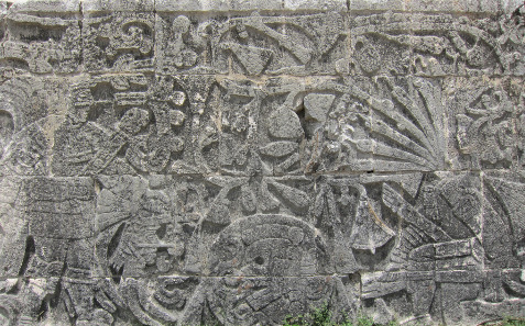 Relief at the side wall of the ball court at Chichen Itza: sacrifice of a man. The blood spills from the neck of the killed whose severed arteries are turning into serpents. Photograph: UK.