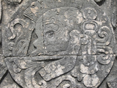 Relief at the side wall of the ball court at Chichen Itz: skull in the ball court. Photograph: UK.