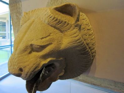 Lion head gargoyle in front of the Temple of Athena. Photo: KW.