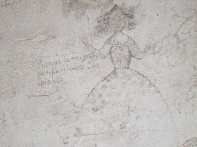 A woman raises her hands to the sky in prayer. Paintings in Palazzo Chiaramonte. Photo: KW.