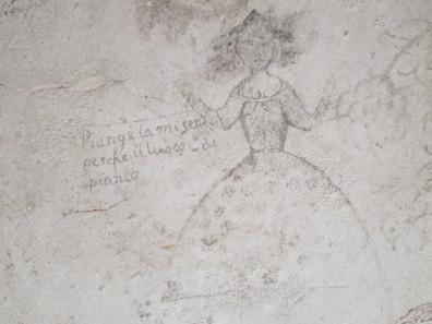 Eine Frau hebt klagend die Hände gen Himmel. Malereien im Palazzo Chiaramonte. Foto: KW.