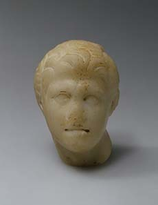 Head of Alexander (fragment of a figure), Asia Minor, Bithynia(?), Roman copy, 1st century BC, after Greek original. 175-150 BC, Fine-grained marble, h 6 cm. ©State Hermitage Museum, St Petersburg.
