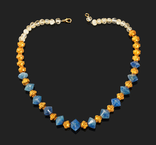 607: Necklace of rotund rock crystal and gold pearls. Gold, Greek, 5-3 century BC L. 43 cm.