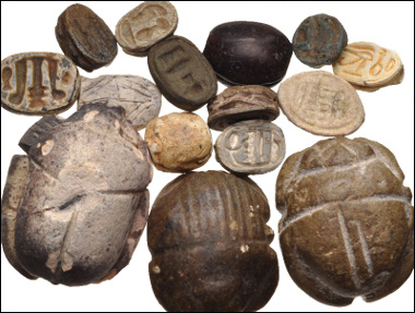 Lot 750: Lot of fifteen (15) scarabs and related pieces. Estimate: $400.