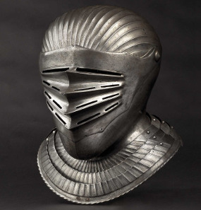 South German Maximilian style close helmet for a fluted suit of armour 1530. Hammer Price: 30,000 Euros.