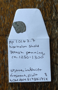 Every newly found coin is kept in a paper sachet with inventory number and short description written on it. Photo: UK.
