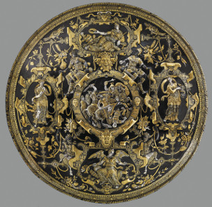 The Ghisi Shield. Hammered iron, silver-plated and damascened with gold. About 1600. This shield is a display piece. Figures on the border symbolise Glory, Prudence, Fame and Strength. The Waddesdon Bequest. © The Trustees of the British Museum.