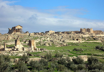 Visitors from throughout the world come to Tunisia, to see the ruins of Dougga with their own eyes. Photograph: Bernard Gagnon / https://creativecommons.org/licenses/by-sa/3.0/deed.en