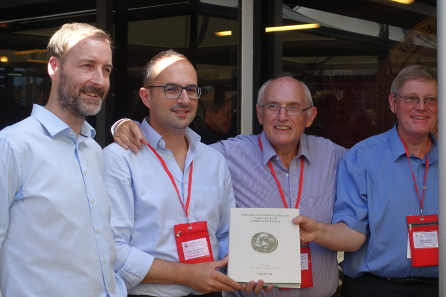 The festschrift in honor of Andrew Burnett is presented in Taormina. From left to right: Philip Skingley / Spink, Dario Calomino, Andrew Burnett, Roger Bland. Photograph: UK.