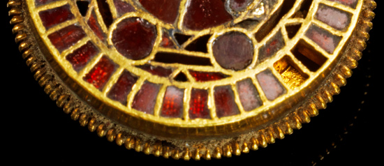 Lot 338: Gold disc fibula with almandine inlays. Langobardic, 6th-7th cent. AD. Round cloisonné disc fibula with ribbons made of gold and almandine inlays on hatched gold foil. Estimate: 20,000,- euros. Provenance: Ex A.P. Collection, since the 1990s.