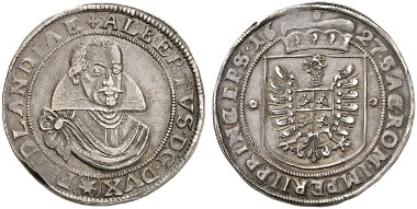 Albrecht von Wallenstein, Duke of Friedland (1625-1634). Taler 1627, minted under the supervision of mint master Georg Reick, Jicin mint. Armoured bust of Wallenstein with military cloak and high collar, viewed from the front. R. Coat of arms crowned with ducal hat. © MoneyMuseum, Zurich.