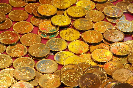 Virtual coins in computer games are either modelled on real money or specimens like these which are used in arcade games. Photograph: Loadmaster (David R. Tribble) / https://creativecommons.org/licenses/by-sa/3.0/deed.en