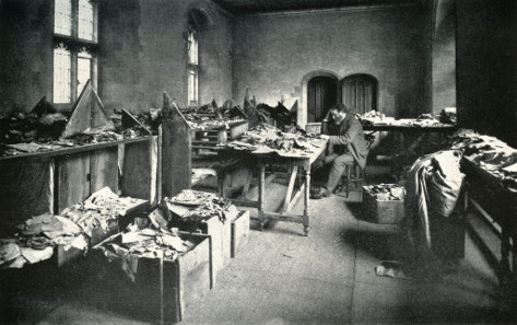 Solomon Schechter at his desk in Cambridge about 1898, working with documents from the Cairo Genizah from the Ben Ezra synagogue. Photograph, late 19th century. © Reproduced by the kind permission of the Syndics of Cambridge University Library.