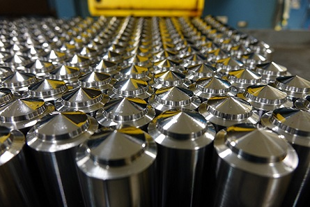 Cylinders of tool steel before being made into dies. Photograph: United States Mint.