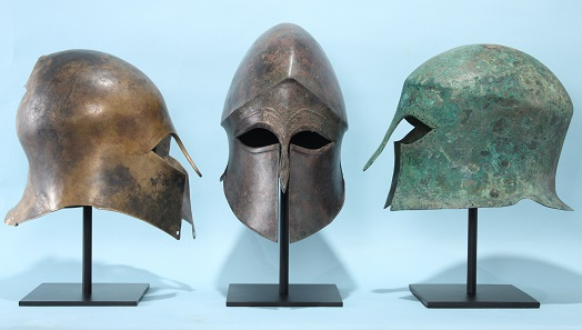 Three Corinthian helmets.