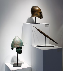 A Corinthian helmet, a Pilos Helmet and a Celtic sword.