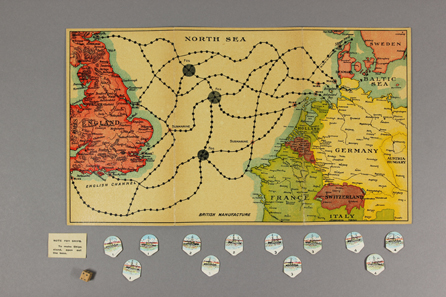 British v. Germans, or Defence [British: manufacturer unknown, c. 1916]. A dice game of naval warfare in the North Sea and the English Channel, with hazards (submarines, mines and fog) marked on the board. A game for 2 or 4 players, each had a set of 3 cardboard images of ships (battleship, destroyer and torpedo boat). The luxury version had metal ships. The object of the game was to 'destroy your opponent's Ships or capture their Ports'. © Bodleian Libraries, University of Oxford.