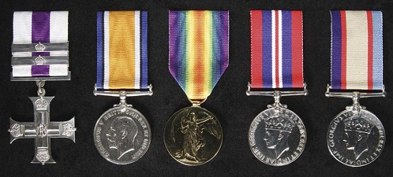Lot 4995: GROUP OF FIVE: Military Cross (GRI), with two Bars; British War Medal 1914-18; Victory Medal 1914-19; War Medal 1939-45; Australia Service Medal 1939-45. Mounted on display board, cleaned, very fine. Estimate: $30,000.