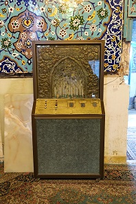 An automated dispenser for prayer candles in the sanctuary, something other religions do too. Photo: KW.