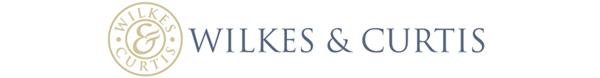 Wilkes & Curtis Logo.