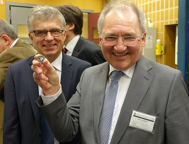 Peter Hofelich (r.) and Mint Director Dr Peter Huber are happy about the first polymer coin being struck. Photograph: UK.