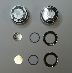 The different parts of the coin and a coining die. Photograph: UK.