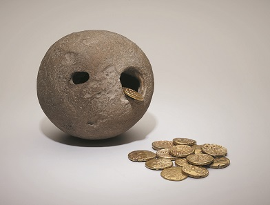 The Westerham hoard, a hoard of gold Iron Age coins found inside a hollow flint in 1927. © The Trustees of the British Museum.