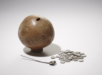 A Roman ceramic money box, silver coins and spoon found by a boy digging in his back garden in Muswell Hill in 1928. © The Trustees of the British Museum.