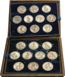 Lot 347: RUSSIA. Alexander I, 1801-1825. Complete medal series of 20 silver medals 1812-1815, on the Russian battles against Napoleon. The medal series was produced between 1834 and 1837, following the design of the Count of Tolstoy and cast into metal by the St. Petersburg-based medalists A. Klepikov and A. Lyalin. Complete object, in silver of utmost rarity. In contemporary wooden casket. Extremely fine to FDC. Estimate: 150,000 euros.